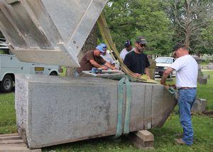 preparing to raise dole monument 300
